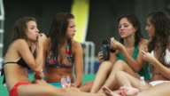girls eating lunch at a water park