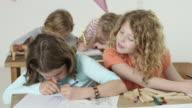 girls in classroom - cribbing