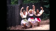 1968 girls in peasant costumes work on dance routine