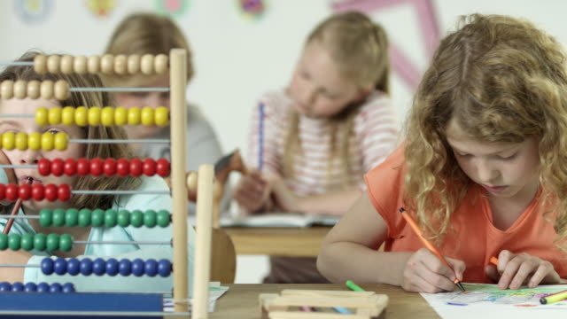 girls in school - learning together