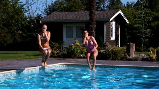 Girls Jumping in Pool