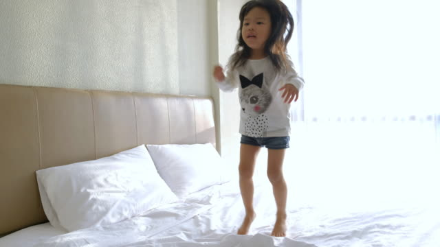 Girls jumping on beds