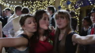 MS Girls (12-17) taking self portrait with camera on prom night / Cedar Hills, Utah, USA