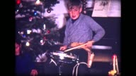1967 girls with dolls, boy with drums and cowboy guns under Christmas Tree