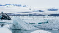 Glacial lake with icebergs floating in water