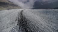 A glacier cuts through the Austrian Alps. Available in HD.