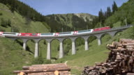 Glacier Express crosses the Bugnei viaduct between Sedrun and Disentis/Mustér