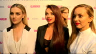 Arrivals and interviews 'Little Mix' group on red carpet as tv presenter and actress Amanda Holden interrupts interview to greet girls SOT on being...