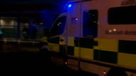 Ambulance and police car arriving SCOTLAND Glasgow Ambulance arriving at scene with flashing lights / Medical staff opening up back of ambulance and...