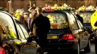 Funeral held for three victims from same family BV Hearses moving away