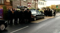 Funeral held for three victims from same family SCOTLAND Dumbarton St Patrick's Church EXT Pallbearers carry coffin from church at funeral of Jack...