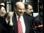 Glasgow Mohammed Sarwar MP posing outside court after being cleared of charges of perverting the course of justice