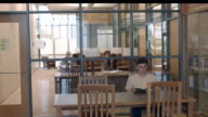 WS TU glass enclosed quiet study room in modern public library with sign naming donor / Rancho Mirage, California, USA