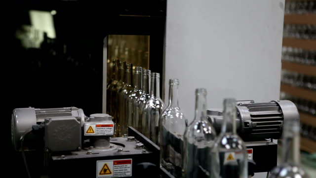 Glass factory. Bottles counting unit.