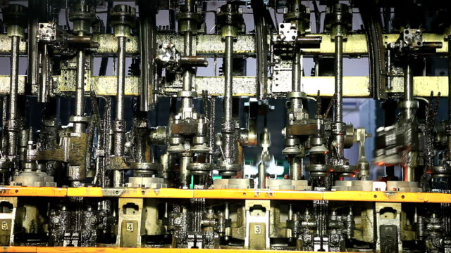 Glass factory. Close up of a Bottle production machine.