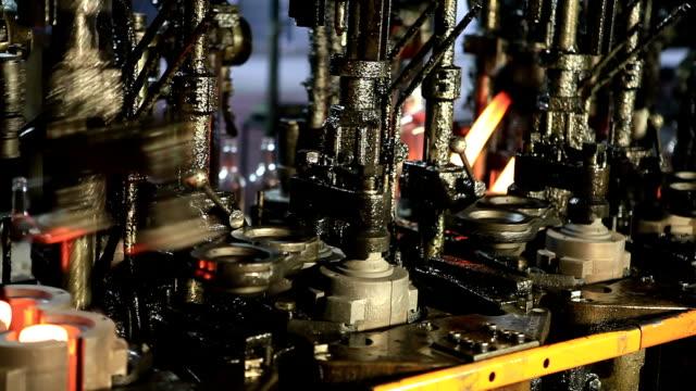 Glass factory. Close up of  hot liquid poured into shape.