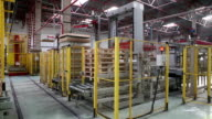 Glass factory. General view of bottle packing machine.