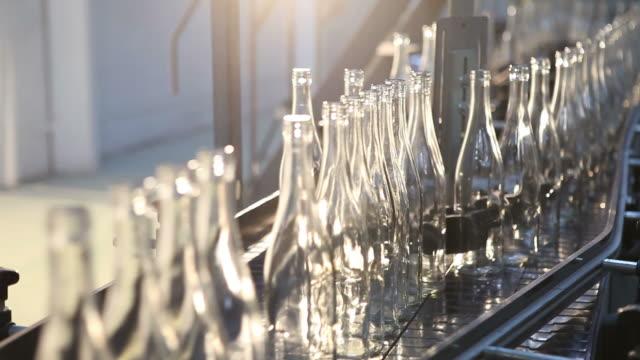 Glass factory. Splitting bottles on a belt conveyor.