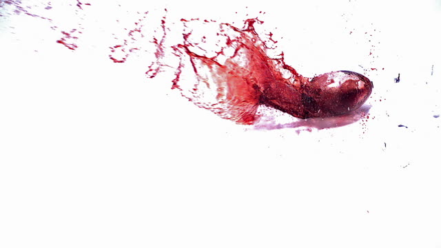 MS SLO MO Glass of red wine falling on floor and splashing wine / Vieux, Normandy, France