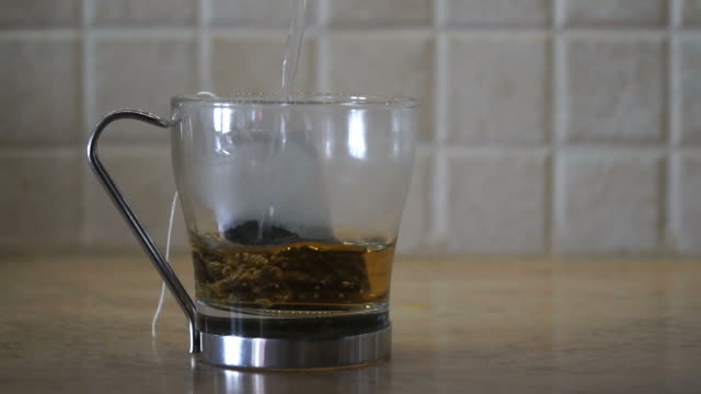 Glass Of Tea in Slow Motion
