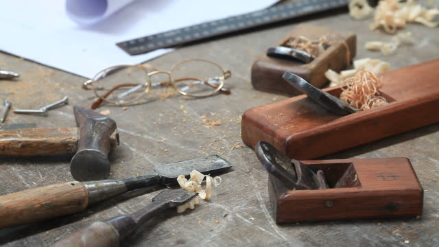 glasses and tools on carpentry table