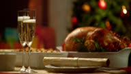 SLO MO glasses of champagne on Christmas table