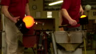 CU Glassmakers Forming Hot Glass With Wood Blocks
