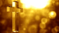 Glassy Cross Spin Background Loop - Textured Golden Glow HD