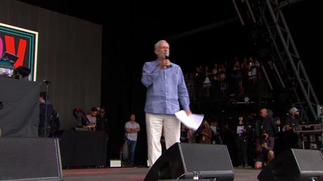 Jeremy Corbyn stage appearance ENGLAND Somerset Glastonbury music festival EXT Michael Eavis onto stage and introduces Jeremy Corbyn SOT / Jeremy...