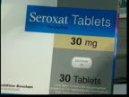 Glaxosmithkline investigated over Seroxat sideeffects ITN Box of Seroxat tablets opened as pills removed Seroxat antidepressant tablet package Pills...