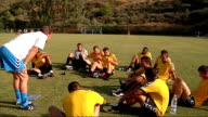 Glen Hoddle Academy for young footballers in Spain players training and competing in friendly match / Glen Hoddle interview Young footballers having...