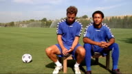 Glen Hoddle Academy for young footballers in Spain players training and competing in friendly match / Glen Hoddle interview Interview with two...