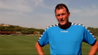 Glen Hoddle Academy for young footballers in Spain players training and competing in friendly match / Glen Hoddle interview Dave Beasant interview...