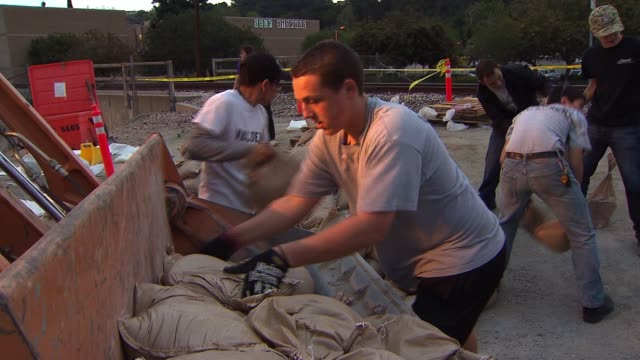 Glendora Residents Prepare and Distribute Sandbags in Anticipation of a Rainstorm after Wildfire Season