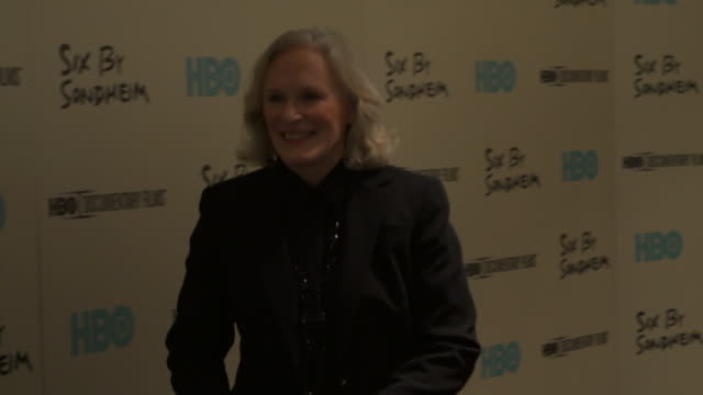 Glenn Close posing for paparazzi along the red carpet at the Modern Museum of Art