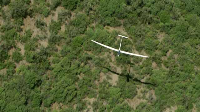 2010 AERIAL Glider flying above scrub desert and foothills of Andes / Santiago de Chile, Gran Santiago, Chile