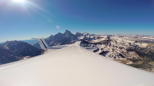 A glider flying near the Grand Teton viewed from the wing