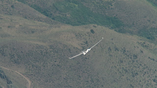 2010 AERIAL Glider flying through rocky mountains / Santiago de Chile, Gran Santiago, Chile