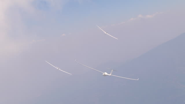 2010 AERIAL Gliders flying over snowcapped Andes mountains / Santiago de Chile, Gran Santiago, Chile