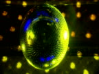 Glitter ball lit up in lime green and blue surrounded by rotating lights