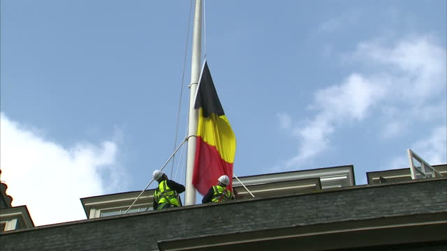 Global Support As Belgium Mourns Victims of Airport and Metro Attacks Showing Exterior shots Belgium flag being hoisted and then flown at half mast...
