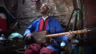 Gnawa playing his Sintir