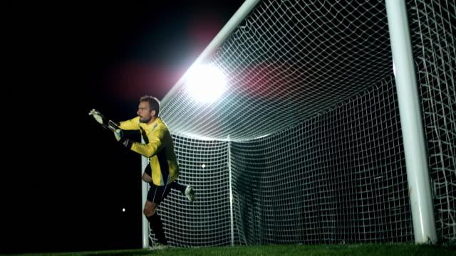 Goalkeeper jump parade, ball in the net