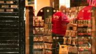 HMV Oxford Street store HMV Southampton store Southampton EXT Staff inside store seen through glass doors / 25 percent off blue cross sale posters /...