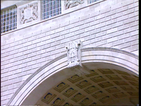 Archway traffic entrance to new MI5 building ZOOM IN crest above arch showing face with blindfold MI6 HQ GV Thames PAN RL ZOOM IN new MI6 HQ building...