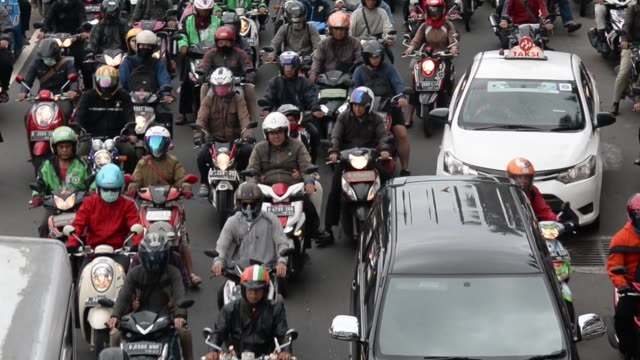 GoJek Indonesia Pt motorcycle taxi riders move along a street in Jakarta Indonesia on Monday March 21 2016