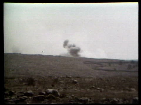 Golan Heights fighting ISRAEL SYRIA BORDER / Syrian shelling of Israeli positions as Israelis move Israeli 130mm artillery gun fired covered corpse...