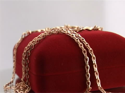 gold chain with pendant of precious stones