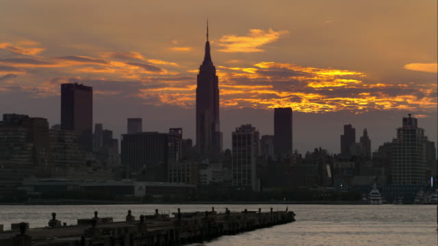 Gold clouds shimmer over the Manhattan Skyline