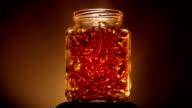 Gold Coloured Vitamins In a Jar